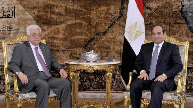Egyptian President Abdel Fattah al-Sisi meets with Palestinian President Mahmoud Abbas at the Presidential Palace in Cairo