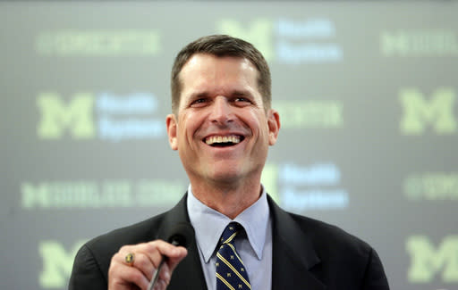 Harbaugh, Michigan staff to guest coach at Alabama, Texas camps