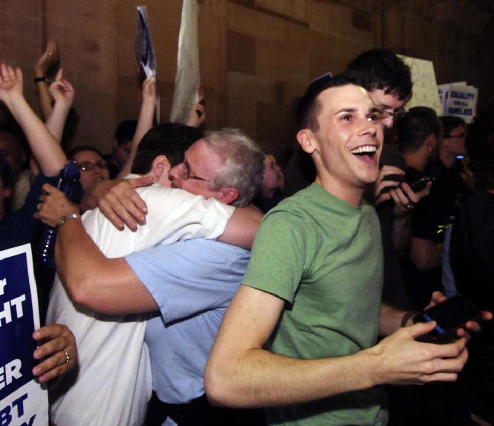 Supporters of same sex-marriage celebrate after Senate members voted and approved the same-sex marriage bill 33-29 during a session of the New York state Senate at the Capitol in Albany, N.Y., Friday, June 24, 2011. (AP Photo/Hans Pennink)