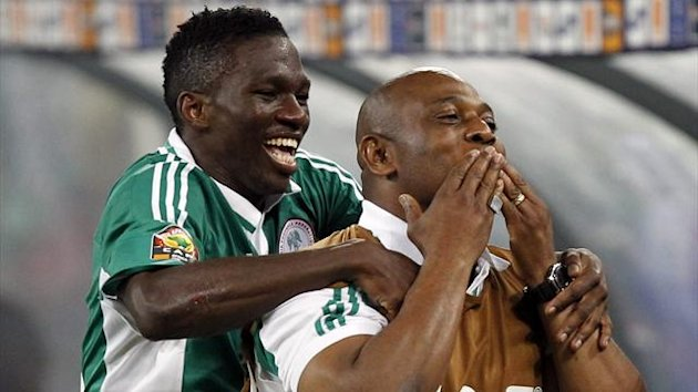 Nigeria's coach Stephen Keshi and Kenneth Omeruo (L) celebrate after winning their African Nations Cup (AFCON 2013) final soccer match against Burkina Faso in Johannesburg, February 10, 2013. (Reuters)