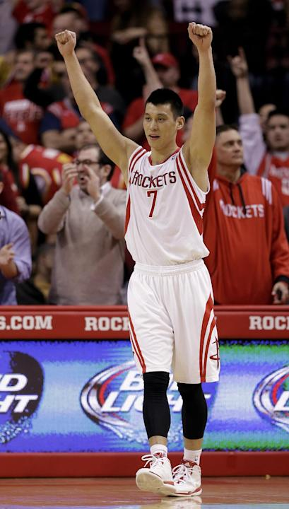 Houston Rockets' Jeremy Lin (7) celebrates after beating the Portland Trail Blazers in overtime in an NBA basketball game Sunday, March 9, 2014, in Houston. The Rockets won in overtime 118-113