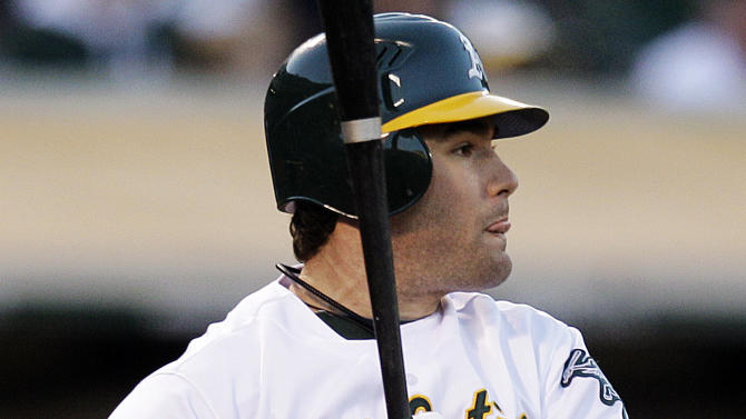 Oakland Athletics' Seth Smith watches his two-RBI single hit off New York Yankees' Freddy Garcia in the third inning of a baseball game, Thursday, July 19, 2012, in Oakland, Calif. (AP Photo/Ben Margot)