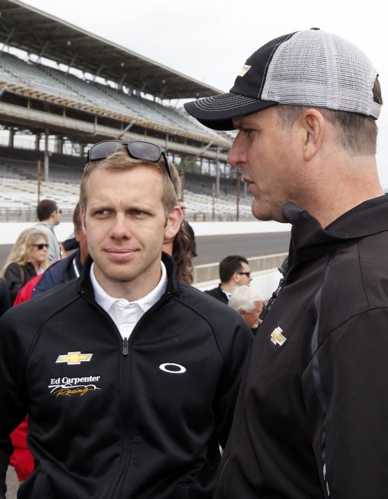 Ed Carpenter talks with Jim Harbaugh before the drivers meeting for the Indianapolis 500 at the Indianapolis Motor Speedway in Indianapolis,