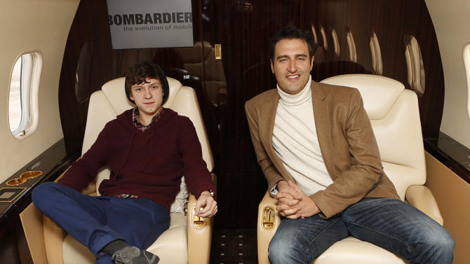 Tom Holland and Bombardier's Paul Vitagliano are seen at The Hollywood Reporter's Palm Springs Shuttle presented by Bombardier Business Aircraft - Day 2, on Saturday, January 5, 2013 in Palm Springs, California. (Photo by Todd Williamson/Invision for Bombardier/AP Images)