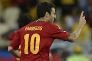 Santi Cazorla and Cesc Fabregas (pictured in July) scored goals in the opening half for world champion Spain who beat Puerto Rico 2-1, stretching their unbeaten streak to 12 straight matches. It marked the first match for Spain since winning back-to-back European Championship titles last month