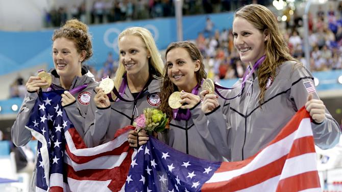 United States' 4 x 100-meter medley relay team from left, Allison Schmitt, Dana Vollmer, Rebecca Soni and Missy Franklin pose with their gold medals at the Aquatics Centre in the Olympic Park during the 2012 Summer Olympics in London, Saturday, Aug. 4, 2012. (AP Photo/Lee Jin-man)