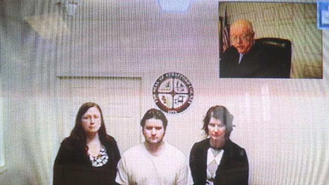 """Seth Mazzaglia, bottom center, is seen during his video arraignment from the Strafford County jail in Dover, N.H. to the district court in Dover  Monday, Oct. 15, 2012. Mazzaglia was charged with killing Elizabeth """"Lizzi"""" Marriott, a 19-year-old University of New Hampshire student. (AP Photo/Jim Cole)"""