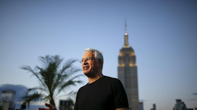 American photographer and documentary film director Louie Psihoyos speaks to the media before images are projected onto the Empire State Building as part of an endangered species projection to raise awareness, in New York