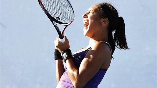 Heather Watson of Britain celebrates defeating Ksenia Pervak of Kazakhstan during their women's singles match at the Australian Open tennis tournament in Melbourne (Reuters)