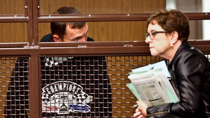 Tobias Dustin Summers, 30, left, talks with his defense attorney Andrea Lemberg during his arraignment at the Los Angeles County Superior Court in San Fernando, Calif. on Thursday, April 25, 2013. Summers faces 37 felony charges, including numerous sexual assault counts, in the alleged abducting and sexual assault of a 10-year-old Los Angeles girl. He was returned to the U.S. Wednesday after being arrested in a Mexican village where he'd checked himself into a rehabilitation facility under a fake name, authorities said. (AP Photo/Los Angeles Times, Mel Melcon, Pool)