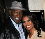 "Actor Michael Clarke Duncan (left) and his girlfriend, TV personality Omarosa Manigault, seen together in Hollywood in February. Duncan, who was nominated for an Academy Award for his role in ""The Green Mile,"" an adaptation of a Stephen King work, died Monday at age 54, his representatives said"
