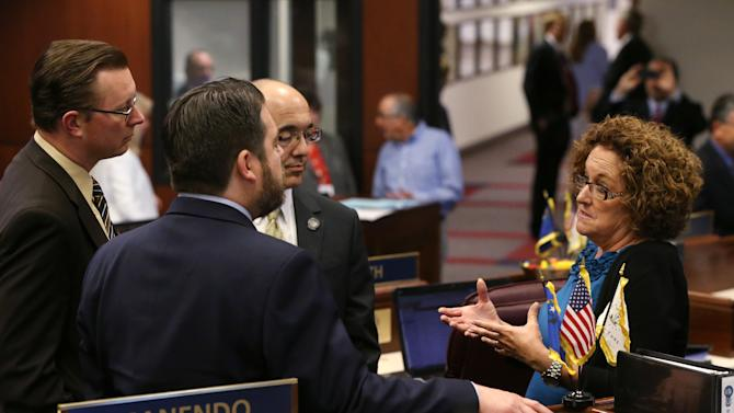 Panels vote to restore state worker pay