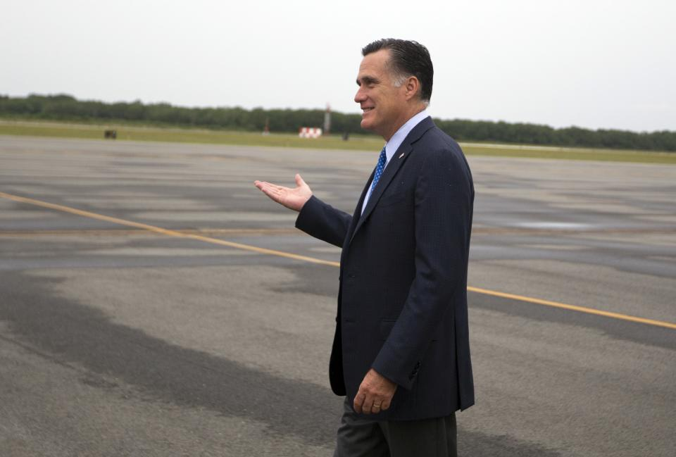 Republican presidential candidate, former Massachusetts Gov. Mitt Romney, arrives at Martha's Vineyard airport for fundraising events on Saturday, Aug. 18, 2012 in West Tisbury, Mass.  (AP Photo/Evan Vucci)