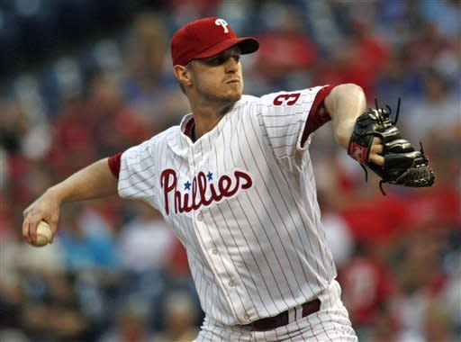 Rollins lifts Phillies over Nationals 4-2