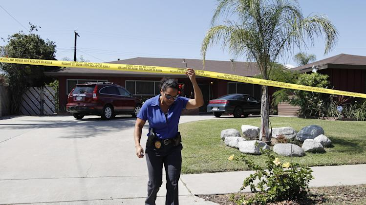 An investigator leaves Rodney King's home in Rialto, Calif., Sunday, June 17, 2012. King, the black motorist whose 1991 videotaped beating by Los Angeles police officers was the touchstone for one of the most destructive race riots in U.S. history, died Sunday. He was 47. King's fiancee called police to report that she found him at the bottom of the swimming pool at their home in Rialto, California, police Lt. Dean Hardin said. (AP Photo/Jae C. Hong)