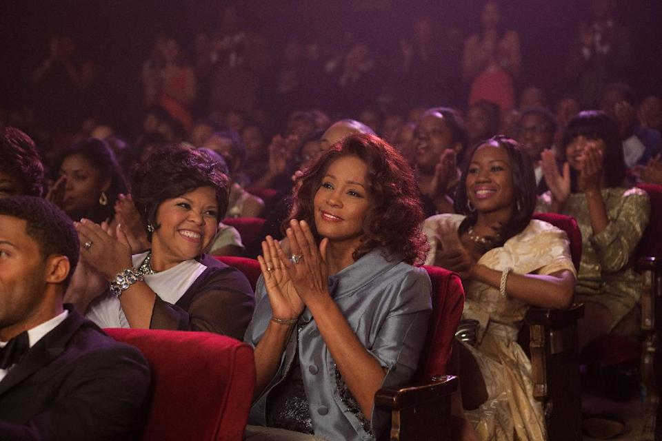 "This undated film image released by TriStar Pictures shows Whitney Houston, center, in a scene from ""Sparkle."" (AP Photo/TriStar Pictures - Sony, Alicia Gbur)"