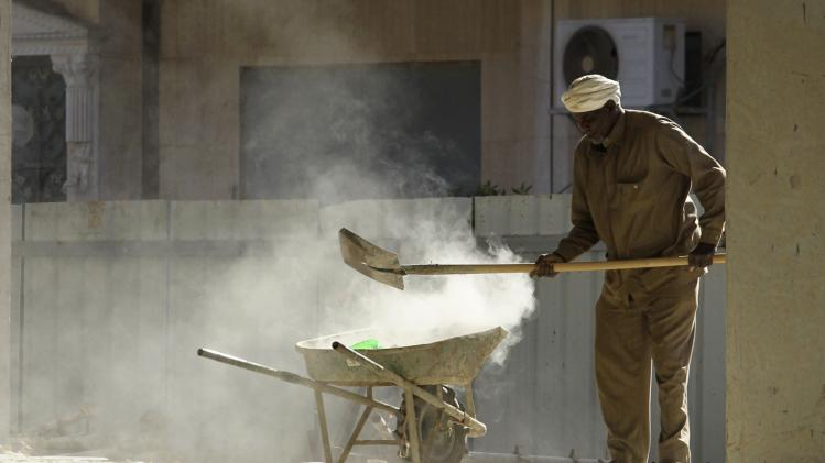 A foreign labourer works at the construction site of a building in Riyadh