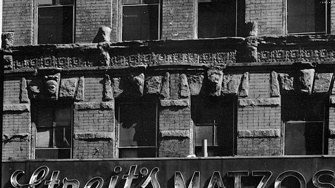 FILE-This file photo from the early 1960s,  provided by the Streit's factory in New York, shows the storefront of the matzo factory at the corner of Rivington St. and Suffolk St. in New York's Lower East Side. Streit's is the oldest factory building in the United States where the unleavened flatbread that's an essential element of Jewish holidays is still churned out. Nearly 1.3 million matzos were baked for April's Passover holiday, and distributed worldwide. Streit's is now counting the days before it closes its eight-decade-old ovens and moves to a 21st century computerized plant somewhere in the New York area.  (AP Photo/Streit's,File)