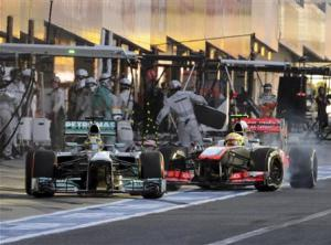 Mercedes Formula One driver Rosberg of Germany disturbs McLaren Formula One driver Perez of Mexico on the pit lane during the Japanese F1 Grand Prix at the Suzuka circuit in Japan