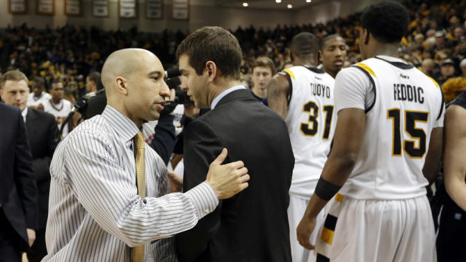 Virginia Commonwealth head coach Shaka Smart, left, and Butler head coach Brad Stevens greet each other after their NCAA college basketball game in Richmond, Va., Saturday, March 2, 2013.  VCU won 84-52.  (AP Photo/Steve Helber)