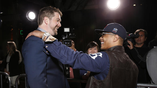 """Director Seth Gordon and Tip """"T.i."""" Harris attend the world premiere of """"Identity Thief"""" at the Mann Village Westwood on Monday, Feb. 4, 2013 in Los Angeles. (Photo by Todd Williamson/Invision/AP Images)"""