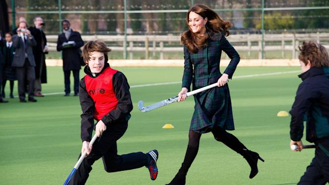 The Duchess of Cambridge playing field hockey in heeled boots