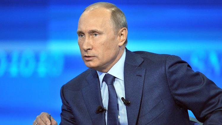 Russian President Vladimir Putin speaks in an annual call-in show in Moscow, Thursday, April 25, 2013. (AP Photo/RIA-Novosti, Mikhail Klimentyev, Presidential Press Service)