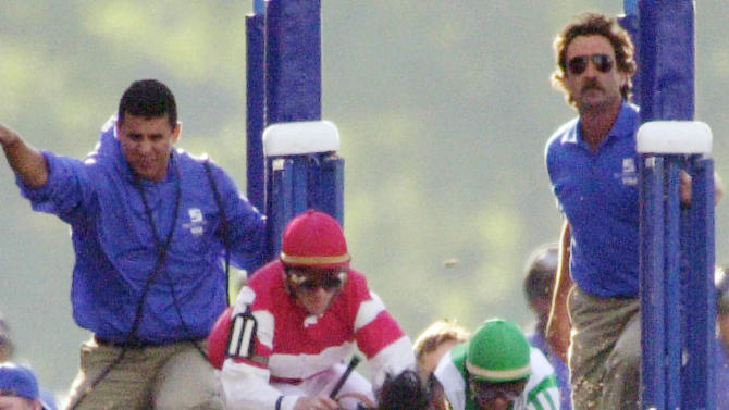 FILE - In this June 8, 2002, file photo, War Emblem and jockey Victor Espinoza, right, stumble into Magic Weisner and jockey Richard Migliore as they leave the starting gate during the Belmont Stakes horse race at Belmont Park in Elmont, N.Y. The front-running War Emblem never recovered from the early collision, resulting in an eighth-place finish behind 70-1 long shot Sarava. As I'll Have Another prepares to attempt to win the Belmont Stakes in his quest to become the 12th Triple Crown champion and first in 34 years on Saturday, June 9, 2012, The Associated Press takes a look at some of the 19 horses who won the Kentucky Derby and the Preakness, but came up short in the final leg of the Triple Crown, and how the race unfolded. (AP Photo/Dave Martin, File)