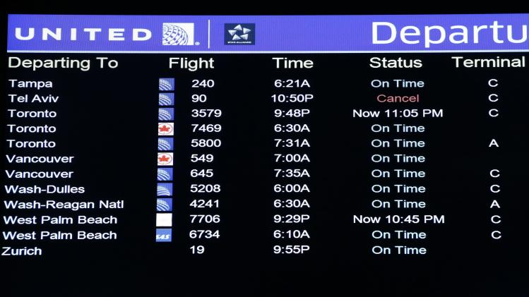 A United Airlines electronic departure board is pictured inside their terminal at Newark International Airport in New Jersey