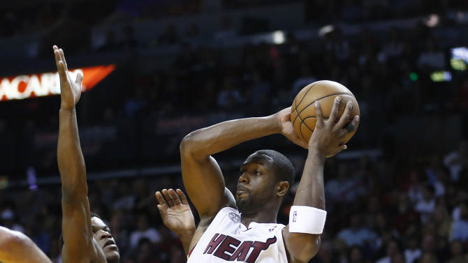Chicago Bulls Jimmy Butler (21) forces Miami Heat's Dwyane Wade (3) to pass the ball during the first half of a NBA basketball game in Miami, Friday, Jan. 4, 2013. (AP Photo/J Pat Carter)