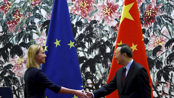 European Union foreign policy chief Federica Mogherini shakes hands with China's State Councilor Yang Jiechi after their joint news conference at Diaoyutai State Guest House in Beijing