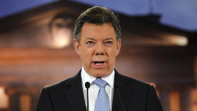 FILE - In this Aug. 27, 2012 file photo, Colombia's President Juan Manuel Santos delivers a speech during a televised address to the nation at the presidential palace in Bogota, Colombia. Santos announced on Tuesday, Sept. 4, 2012 a preliminary accord with Colombia's main leftist rebel group to launch peace talks to end a century-old conflict that has claimed tens of thousands of lives. (AP Photo/Fernando Vergara, File)