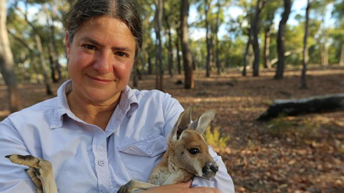 "This image released by PBS shows anatomist Joy Reidenberg with a baby kangaroo from the four-part series, ""Sex in the Wild,"" premiering Wednesday, July 16, on PBS. (AP Photo/PBS)"