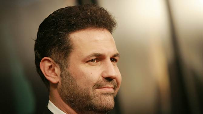 """FILE - This Dec. 10, 2007 file photo shows author Khaled Hosseini at the """"There Will Be Blood"""" premiere at the Ziegfeld Theatre in New York. Hosseini's next novel will be a journey across time and space. The author of the million-sellers """"The Kite Runner"""" and """"A Thousand Splendid Suns"""" has finished his third book, """"And the Mountains Echoed."""" Riverhead Books, an imprint of Penguin Group (USA), announced Monday, Oct. 29, 2012, that the new book comes out May 21. (AP Photo/Evan Agostini, dile)"""