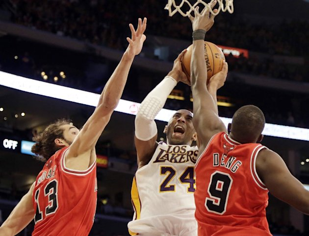 Los Angeles Lakers guard Kobe Bryant (24) shoots as he is defended by Chicago Bulls center Joakim Noah and forward Luol Deng (9), of Sudan, in the first half of an NBA basketball game in Los Angeles S