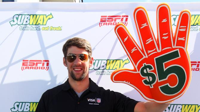IMAGE DISTRIBUTED FOR SUBWAY - Subway Famous fan and all time gold medalist Michael Phelps seen outside at the Subway Fresh Take Green Room, on Friday, Feb. 1, 2013 in New Orleans. (Photo by Barry Brecheisen/Invision for SUBWAY/AP Images)
