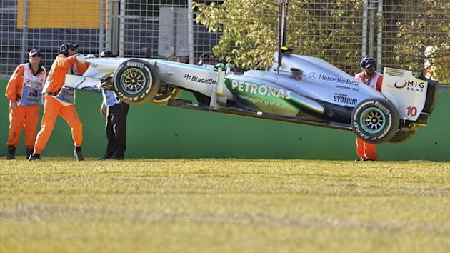 Track marshalls remove the Mercedes of Lewis Hamilton of Britain after he crashed in a gravel trap during the second practice session for the Formula One Australian Grand Prix in Melbourne on March 15, 2013 (AFP)