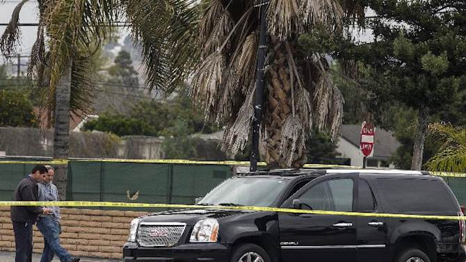 A police investigator looks under a disabled SUV left on Red Hill Ave. in Tustin, Calif., Tuesday, Feb. 19, 2013. Police say a chaotic 25-minute shooting spree through Orange County left a trail of dead and injured victims before the shooter killed himself.  There were multiple crime scenes in Tustin and Orange and many more victims who were shot at but unhurt, said Tustin Lt. Paul Garaven.  Tustin is about 35 miles southeast of downtown Los Angeles. (AP Photo/Damian Dovarganes)