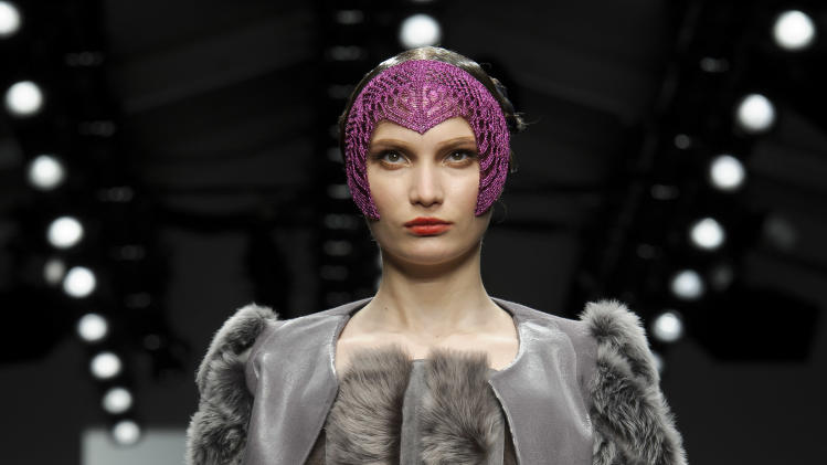 A model wears a design from the Bora Aksu collection during London Fashion Week, Friday, Feb. 15, 2013, in London. (Photo by Jonathan Short/Invision/AP)