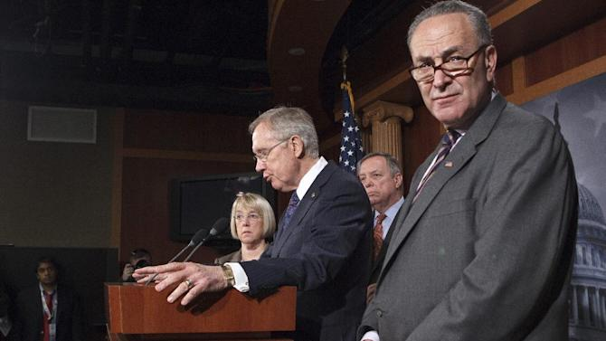 Senate Majority Leader Harry Reid of Nev., second from left, accompanied by fellow Senate Democratic leaders, speaks during a news conference on Capitol Hill in Washington, Thursday, March 8, 2012, to talk about roadblocks on passing the highway bill. From left are, Sen. Patty Murray, D-Wash., Reid, Senate Majority Whip Richard Durbin of Ill., and Sen. Charles Schumer, D-N.Y. (AP Photo/J. Scott Applewhite)