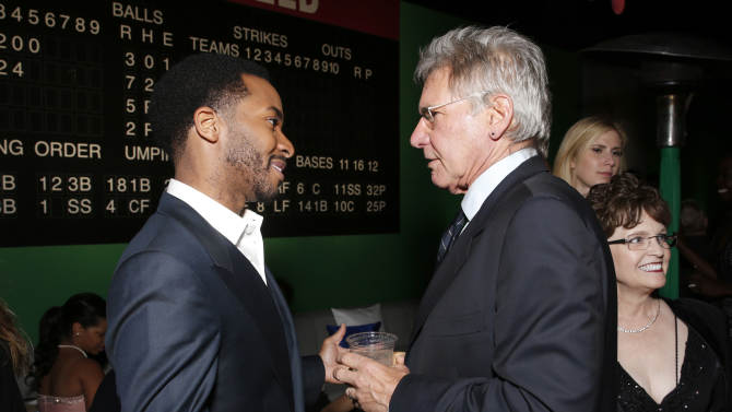 """Andre Holland and Harrison Ford attend the after party for the LA premiere of """"42"""" at the TCL Chinese Theater on Tuesday, April 9, 2013 in Los Angeles. (Photo by Todd Williamson /Invision/AP)"""