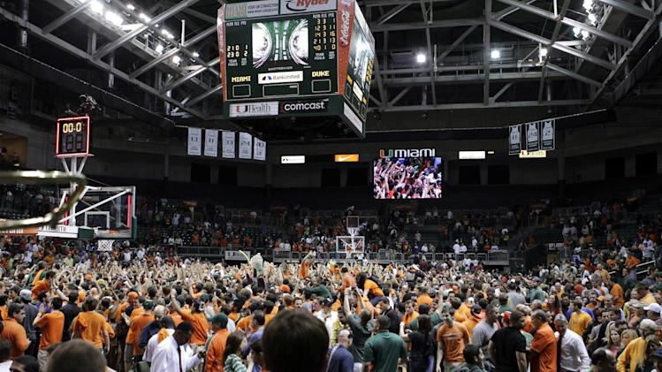 Miami fans rush the court to celebrate after defeating Duke 90-63 in an NCAA college basketball game in Coral Gables, Fla., Wednesday, Jan. 23, 2013. (AP Photo/Alan Diaz)