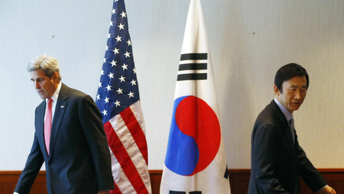 U.S. Secretary of State John Kerry, left, and South Korea's Foreign Minister Yun Byung-se arrive for a meeting in Munich, Germany, prior to the start of the Munich Security Conference, Friday, Feb. 12, 2016. (AP Photo/Matthias Schrader)