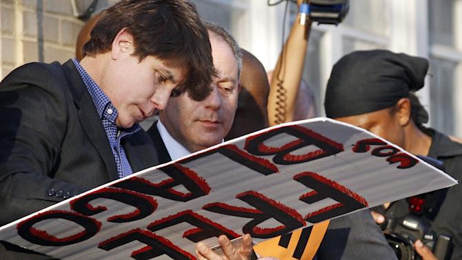 FILE - This March 14, 2012 file photo shows former Illinois Gov. Rod Blagojevich autographing a 'Free Gov. Blago' sign for one of his supporters outside his home in Chicago the day before The 55-year-old Democrat was due to report to a prison in Colorado to begin serving a 14-year sentence on corruption charges. The Imprisoned ex-Gov. gets what's likely his last chance to win his freedom as his appeal goes before the 7th U.S. Circuit Court of Appeals for oral arguments Friday, Dec. 12, 2013 in Chicago. (AP Photo/M. Spencer Green, File)