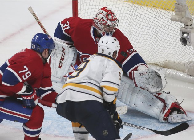 Buffalo Sabres' Steve Ott scores on Montreal Canadiens goalie Carey Price during overtime NHL hockey action in Montreal