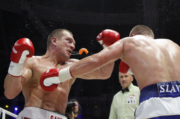 Ukraine's Glazkov punches Germany's Airich during WBC Baltic Silver heavyweight title fight in Moscow