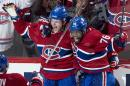 Montreal Canadiens' Alex Galchenyuk, left, celebrates his winning goal over the Ottawa Senators with teammate P.K. Subban during first period overtime in Game 2 of an NHL hockey first-round playoff series, Friday, April 17, 2015 in Montreal. (Paul Chiasson/The Canadian Press via AP) MANDATORY CREDIT