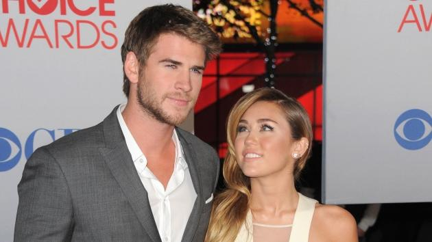 Liam Hemsworth and Miley Cyrus arrive at the People's Choice Awards 2012 at Nokia Theatre LA Live in Los Angeles on January 11, 2012 -- Getty Premium