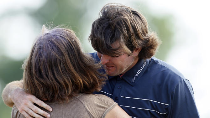 Bubba Watson, right, hugs his mother Molly after beating Webb Simpson in a sudden death playoff on the 18th green during the final round of the Zurich Classic golf tournament in Avondale, La., Sunday, May 1, 2011. (AP Photo/Patrick Semansky)