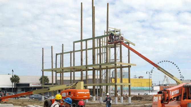 In this March 7, 2012 photo, workers install supports for a zip line near the shore in Myrtle Beach, S.C. The attraction, to open in April, stands where the Myrtle Beach Pavilion amusement park once stood. (AP Photo/Bruce Smith)